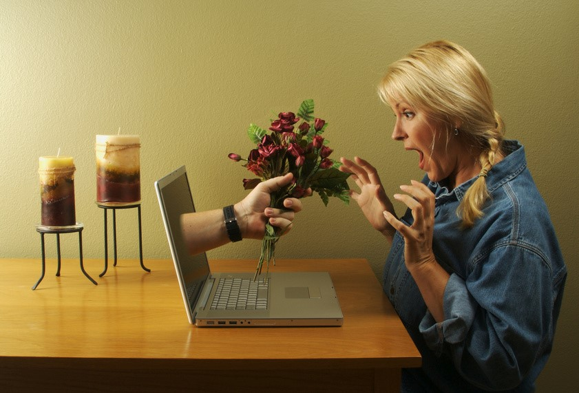 Lady at Computer Bunch of Flowers
